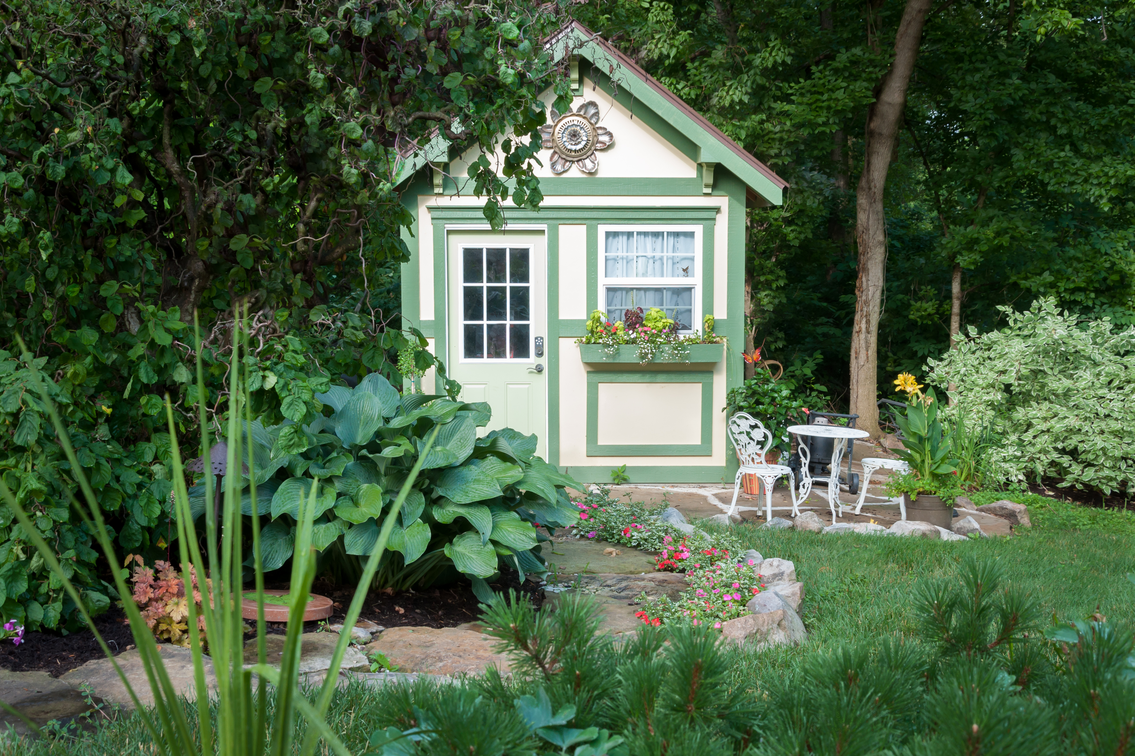 Shed in a garden designed by Bauer Falls St Louis Waterfalls