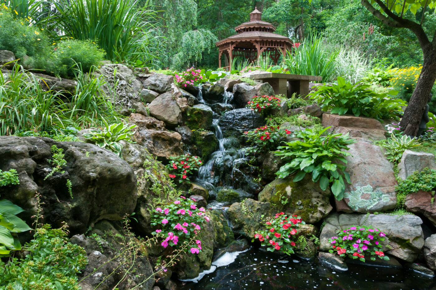 St. Louis based landscape company Bauer Falls designs waterfall gardens.