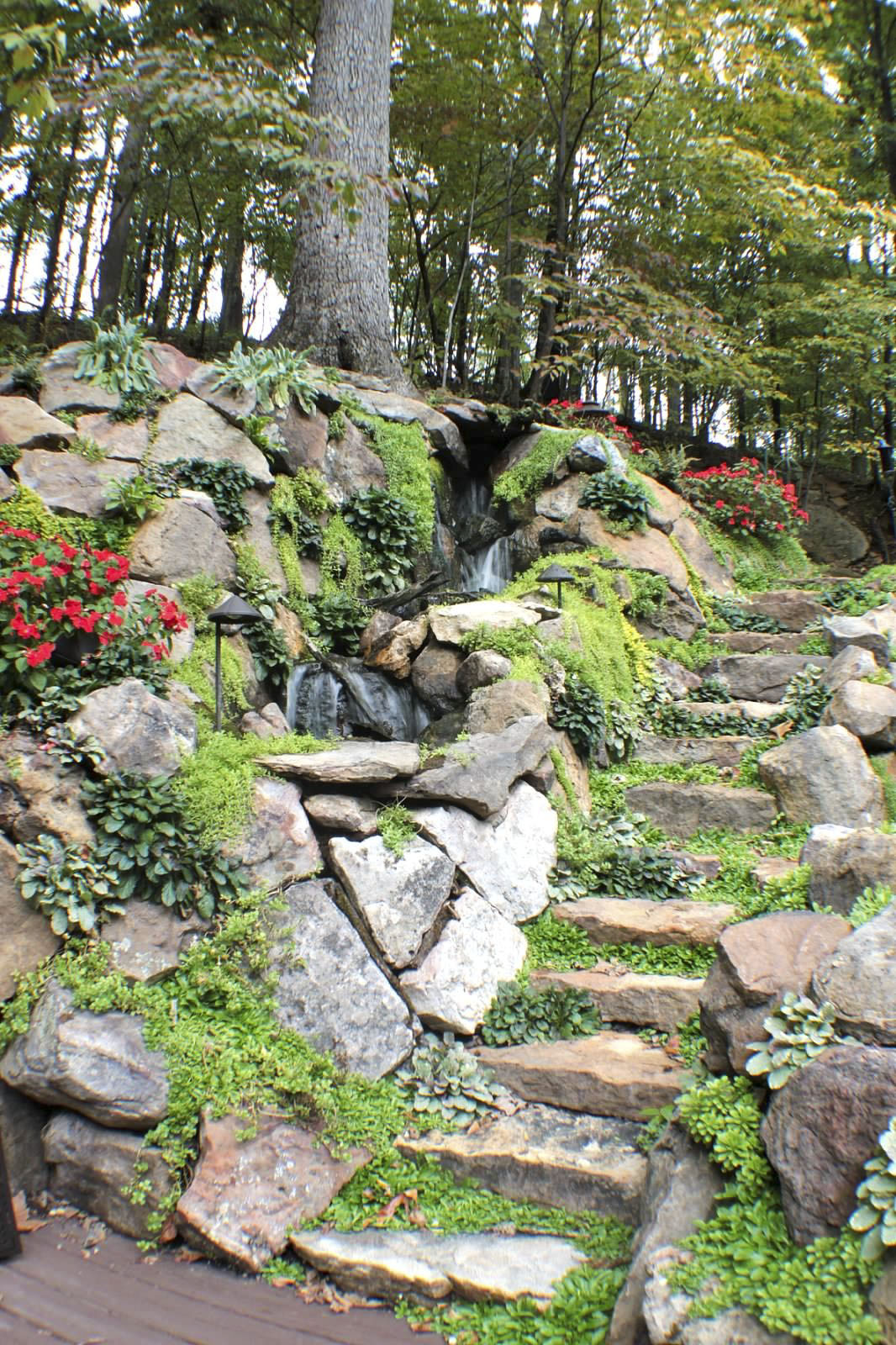 Natural stone stairwell by Bauer Falls